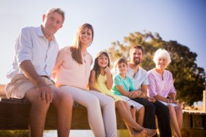 Smiling family grand parents, parents, and kids glad they chose the Fort Collins family dentist Aspen Dental Care