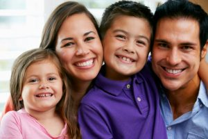 happy family with beautiful smiles thanks to their fort collins family dentist