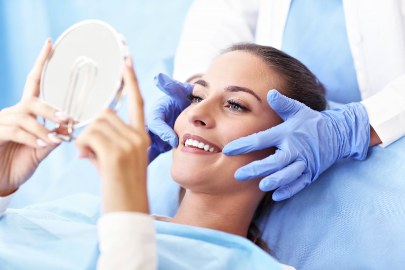 Woman smiling with cosmetic dentist in Ft. Collins