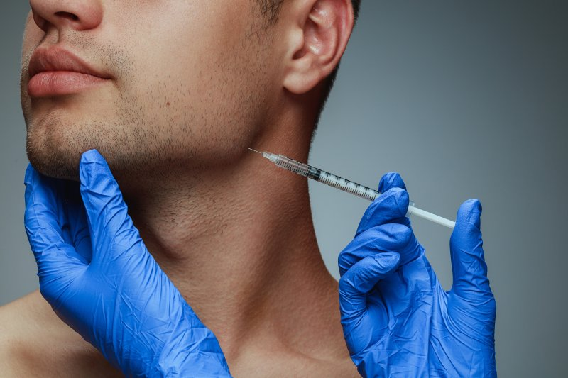 Closeup of Botox being inserted into jawbone